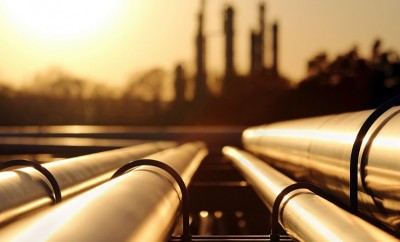 golden sunset in crude oil refinery with pipeline system